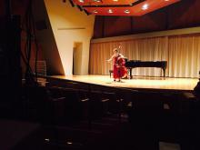 Mikyung Sung warming up before recital