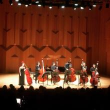 Mikyung Sung taking bows with 6Bass after recital
