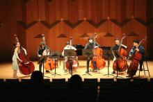 Mikyung Sung warming up with double bass sextet before recital